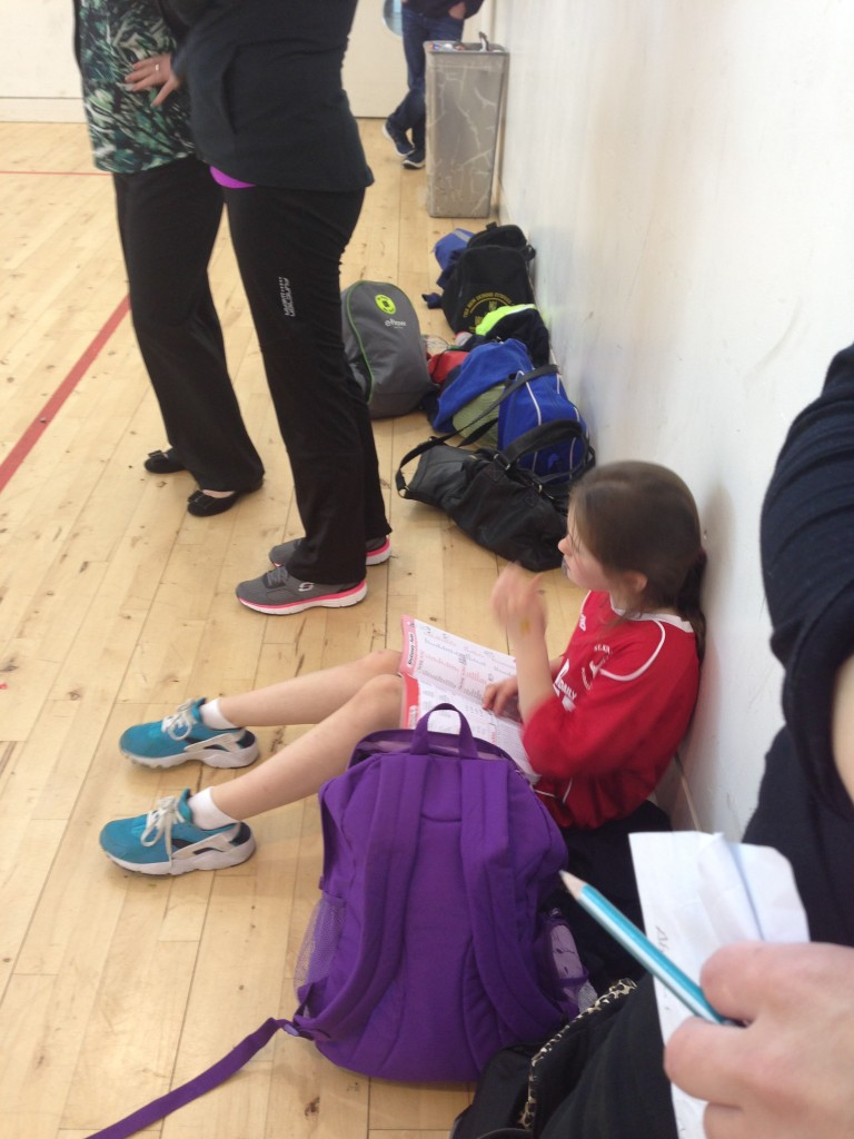 Kate is getting a head start on her homework between matches!